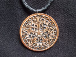 Sacred geometry carved leather pendant by dionesambrozius