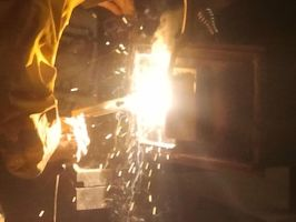 My dad welding 1/2 by littlewolfmoccasin