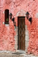 A door in a pink wall by PeterTBexley