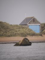 boathouse with the blue door by Blue-eyed-Kelpie