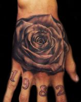 Black and Gray rose on hand by hatefulss