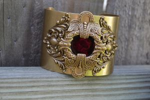 Victorian inspired red center, filigree cuff by MonstersInThewall