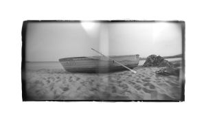 Boat On The Beach Near Primorsko by Veniamin