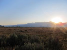 Wyoming field and sunset by xdancingintherain