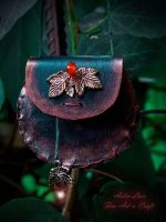 Rustling leaves leather necklace-wallet by Gwillieth