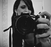 photographers eye by jaded-ink