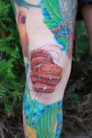 Knee cap emerald tree boa baby tattoo by danktat