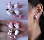 Sylveon earrings by LayzeMichelle