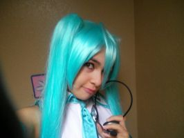 Miku loves her headphones by Allison02Uchiha