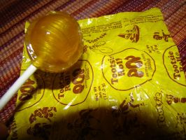 Banana Tootsie Pop by stephuhnoids