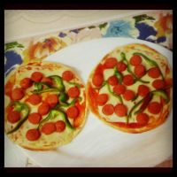 mini pizzas by Alucard4