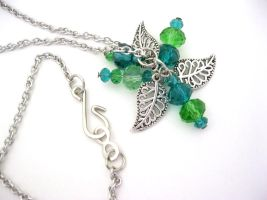 Bright green filigree leaf necklace by faranway