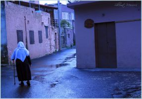Alone in a wet street by ShlomitMessica