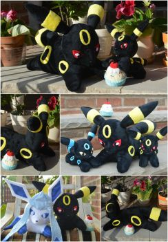 Umbreon and her family by PlushPrincess