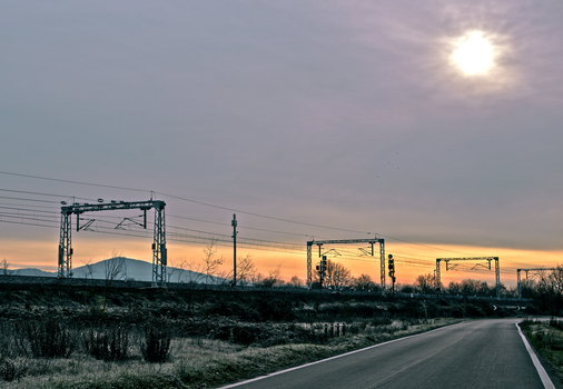 Railroad at dawn through the frozen countryside by cortomaltese219