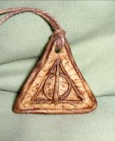 Deathly Hallows symbol pendant by valenceleclerc