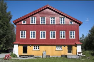 Red wooden house by enframed