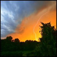 Lightning at sunset by JoInnovate