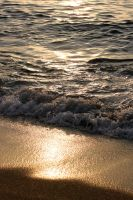 Waves and the sunset... by ApertumCodex