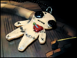 Voodoo Doll Necklace by GrandmaThunderpants