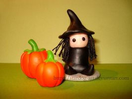 Witch with pumpkins by stardog-art