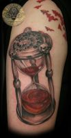 Blood clock script skulls tat by 2Face-Tattoo