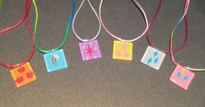MLP FiM Cutie Mark Necklaces by SeekingElegance