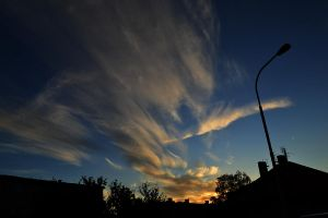 clouds over houses by Katie537
