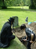 grave digging by MrSoles