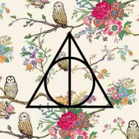 Deathly Hallows on flowers by lucy23swift