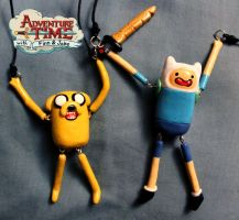 AT: Finn and Jake Necklaces by crymsonlyze