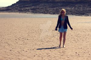 walking on the beach. by lucyparryphotography