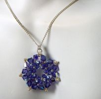 Tanzanite crystal pendant by elderarc