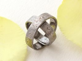 Our damascus weddingrings by Ugrik
