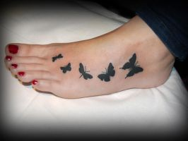Butterfly tattoo by carobni