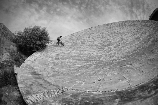 Bmxing Inside the Radar Dish by Elroymedia