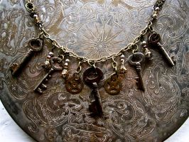 Keys, Gears and Topaz Necklace by thevampirepandora