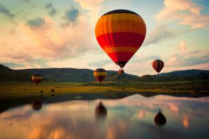 Hot Air Ballon over water by larissalognayfineart