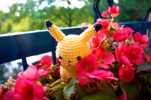 Amigurumi Pikachu Amongst the Flowers by FudgeNuggets