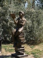 A statue that reads by Stock-Photoz