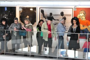 people and PICTURES at an exhibition by Rikitza